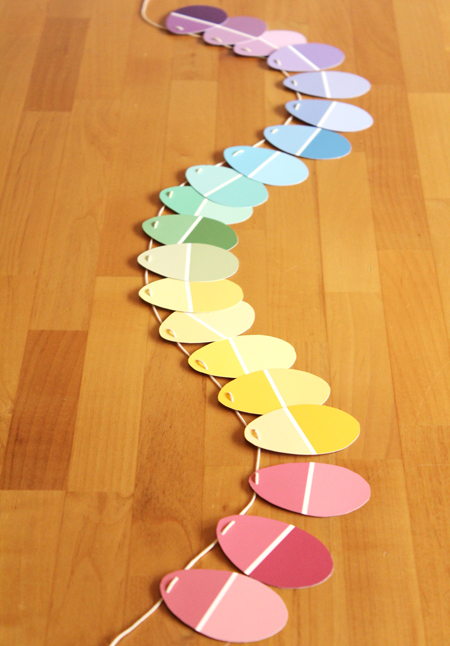 An easy upcycled Easter garland using paint chips - LOVE the pretty colors and how the lines on the paint chips mimic the lines in plastic Easter eggs.