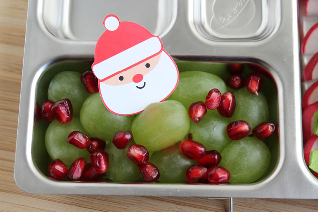 Put grapes on a Santa pick, then sprinkle with pomegranate seeds for a Christmasy fruit cup.
