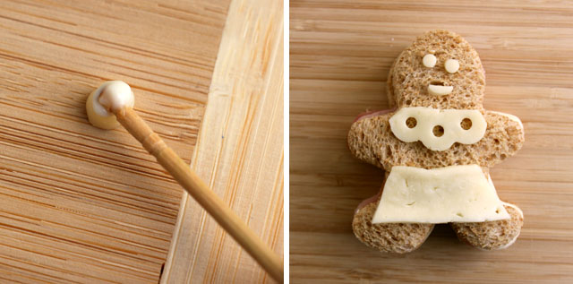 """Glue cheese shapes to the bread to create a """"gingerbread"""" girl."""